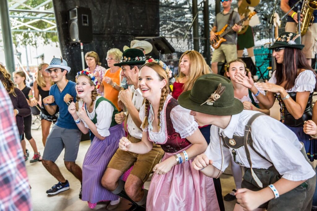Young people dancing in german costume at the Fredericksburg Octoberfest.