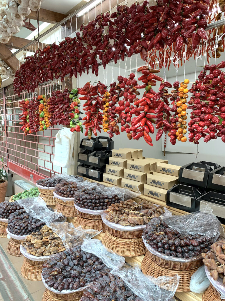 Dates and dried chillies for sale at the Funchal Market in Madeira Portugal.