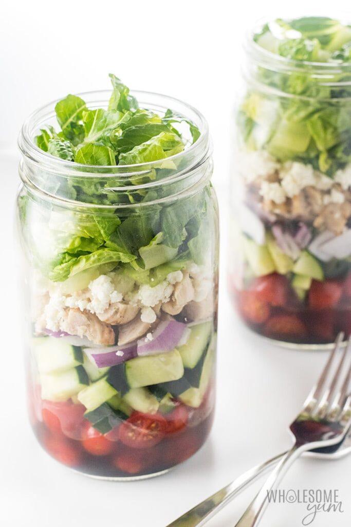 Greek salad in a mason jars.