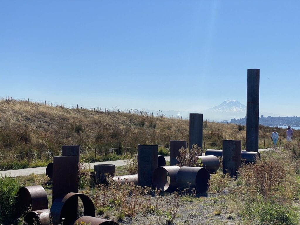 Modern cylindrical sculptures at Dune Peninsula Park at Point Defiance Park.