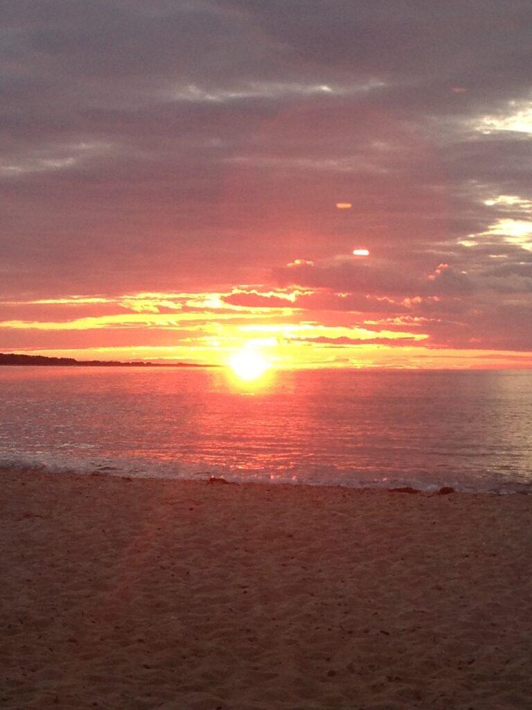 sunset over the water in Menemsha, Massachusetts