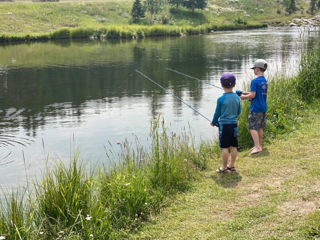 Two boys fishing at Breckenridge's Blue River.