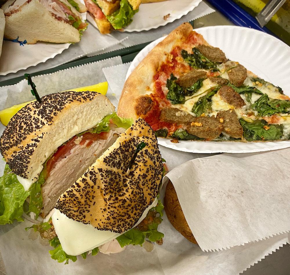 Deli sandwich and slice of pizza from Little Deli & Pizzeria in Austin, TX