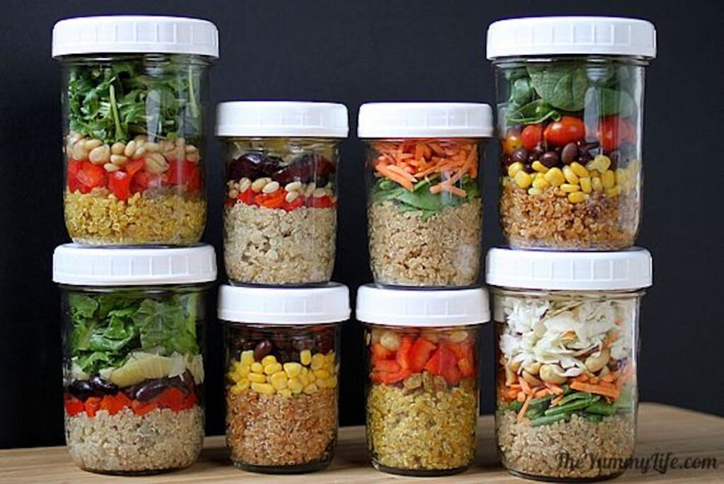 A selection of mason jar salads varying in size.