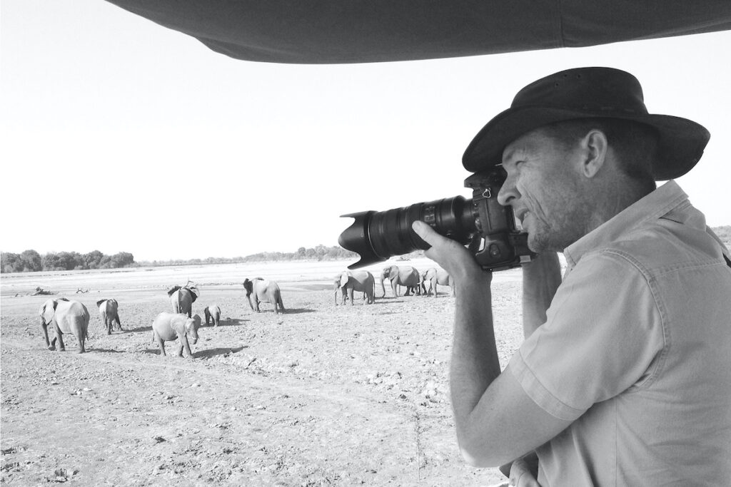 Patrick Bentley taking photos of elephants