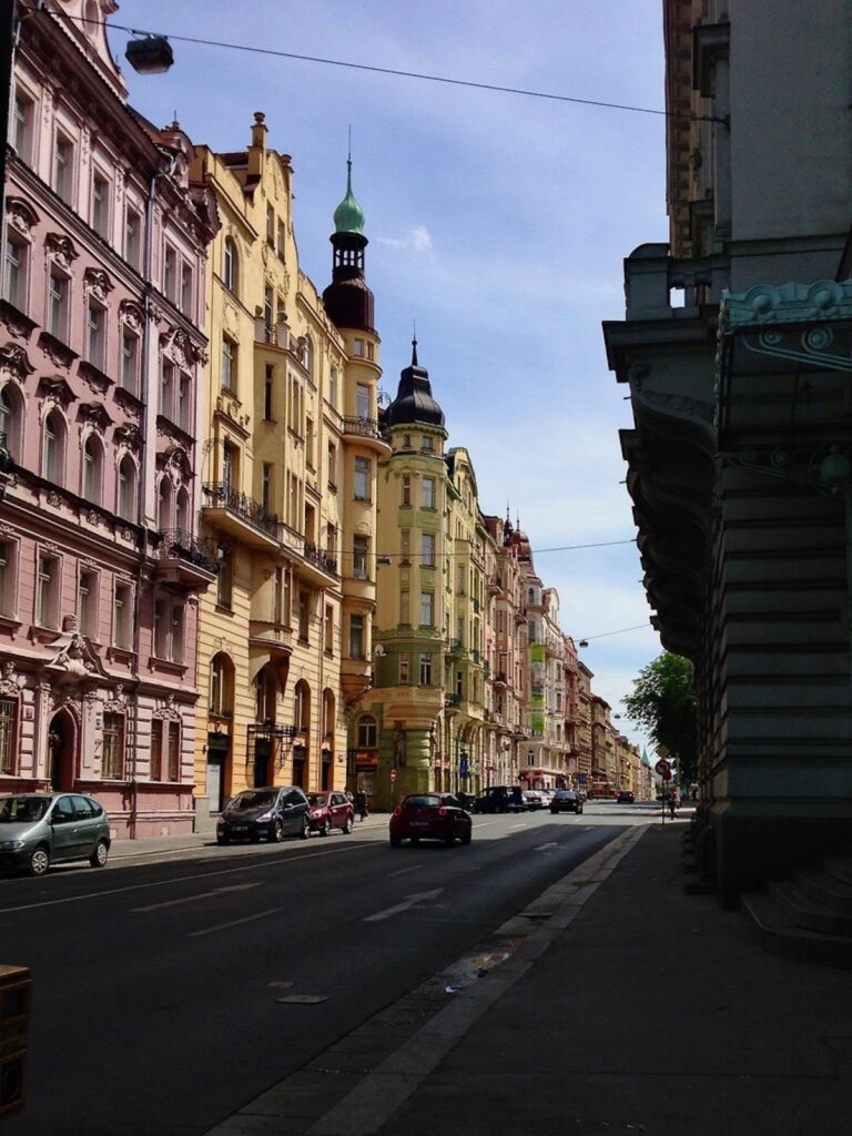 City street in Prague with colorful buildings.