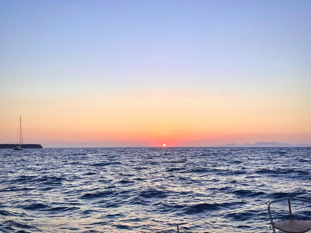 Santorini sunset in the Greek Isles on a catamaran cruise
