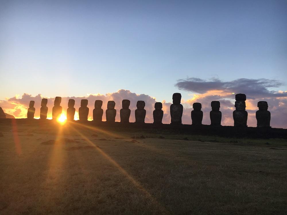 sunrise at Easter Island behind The Ahu Tongariki