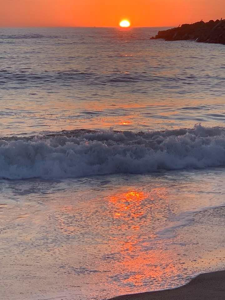 bright orange sunset over the Pacific on the beach in Bandon, Oregon