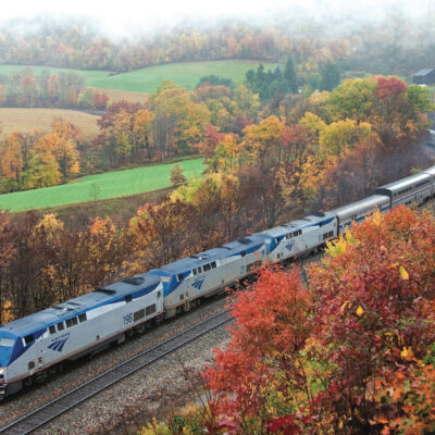 Amtrak Capitol Limited driving through gorgeous fall foliage