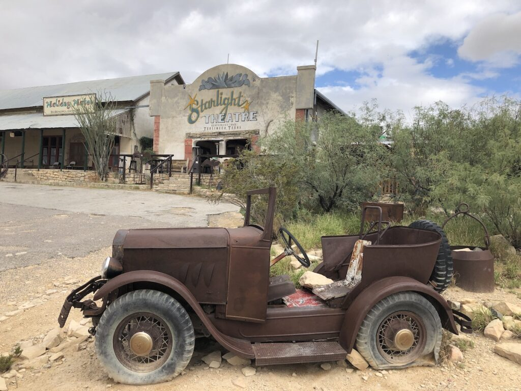 Ghost town of Terlingua with abandon old truck and buildings.