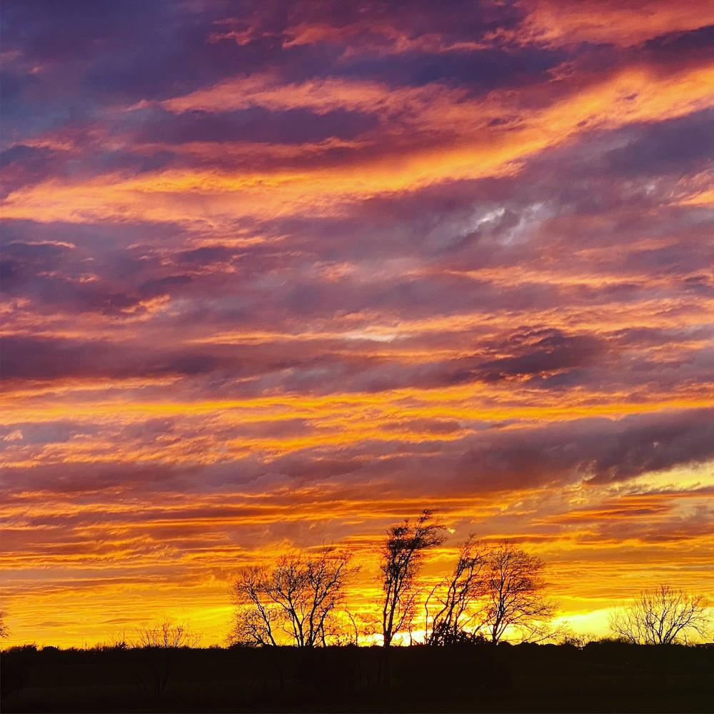 Fiery orange and purple Texan sunset. Photo taken near Walnut Springs, TX.