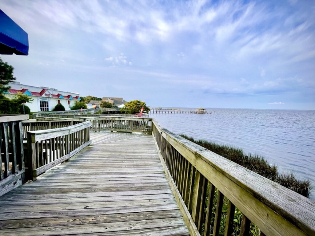 The Duck Boardwalk on an overcast day that connects the restaurants and shops along the Currituck Sound.