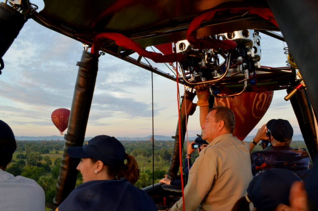 people watching sunrise from a hot air ballon in Bagan Myanmar
