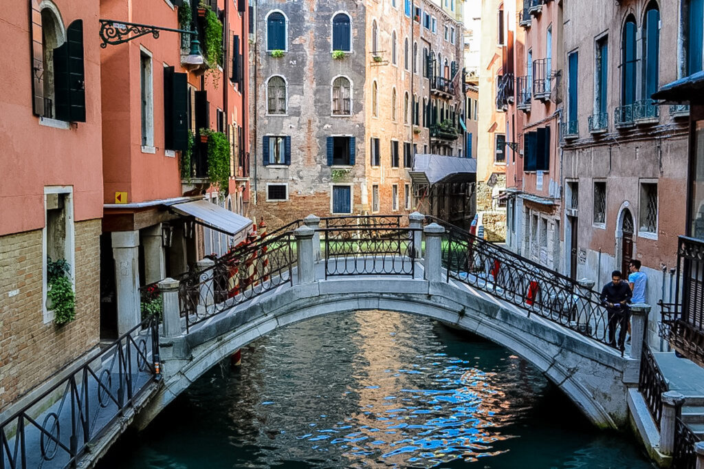 Bright sunshine day at a Venice Canal and Bridge.