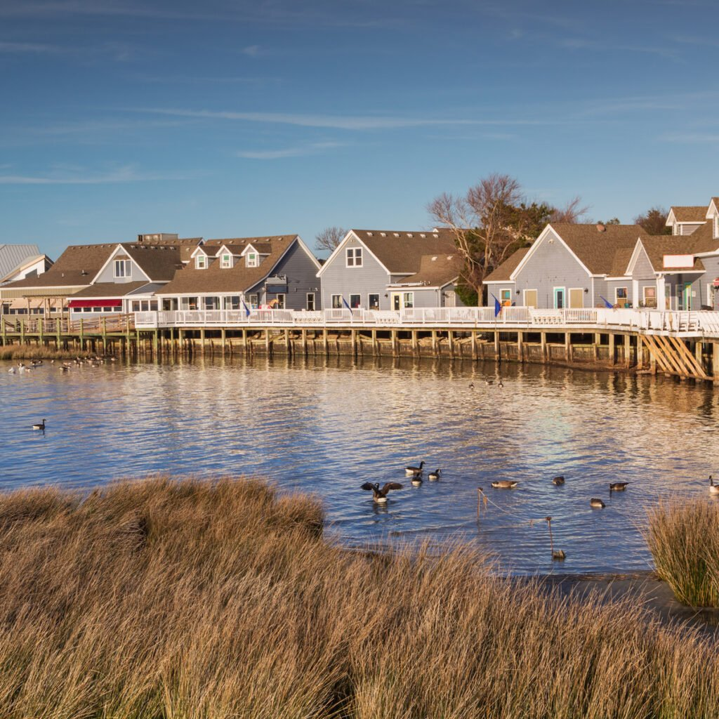 Waterfront shops and boardwalk along the Currituck Sound in Duck, North Carolina on the Outer Banks.