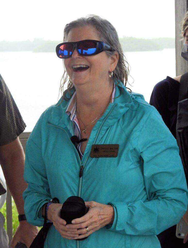 "Chelle Walton wearing EnChroma glasses in J.N. ""Ding"" Darling National Wildlife Refuge."
