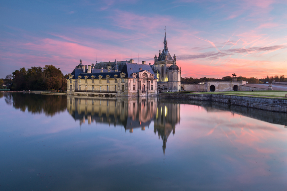 Chantilly Castle at sunrise in France.