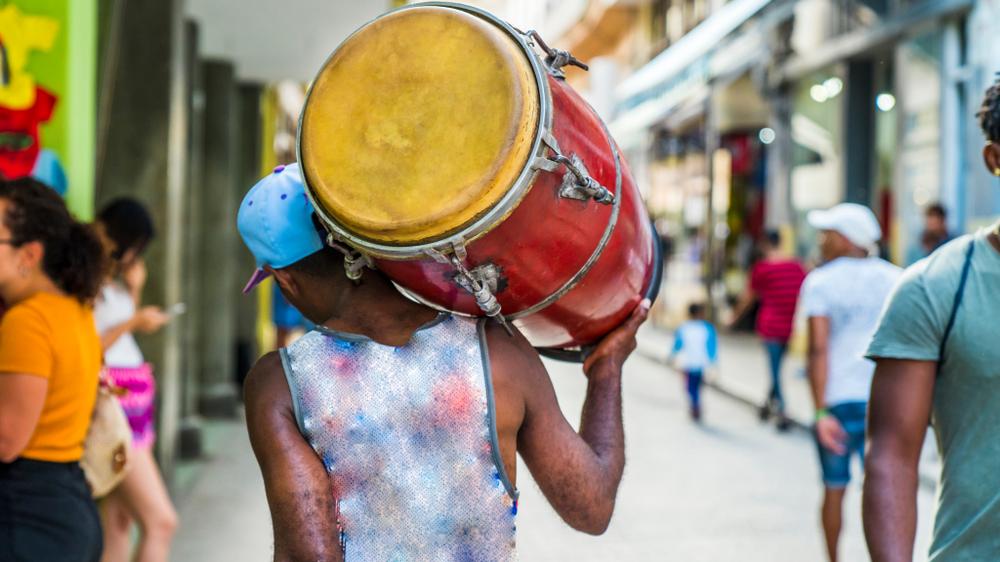 Havana, Cuba.  Man carrying a drum.