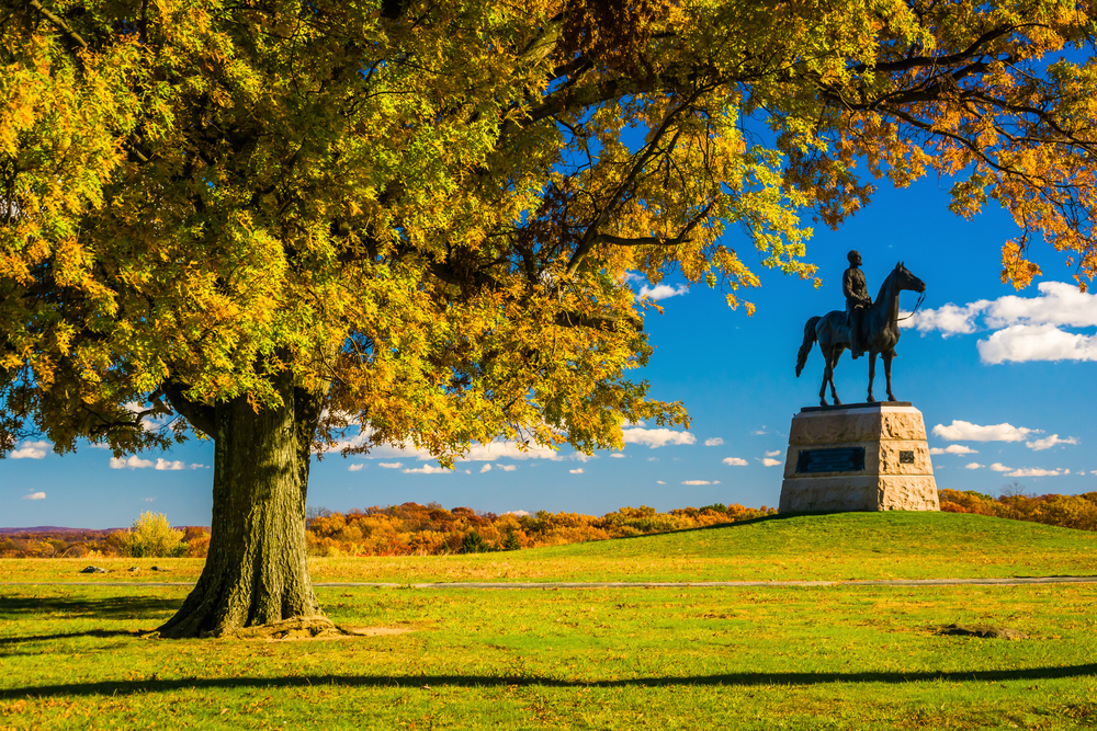 Tree and statue in Gettysburg National Military Park during fall.