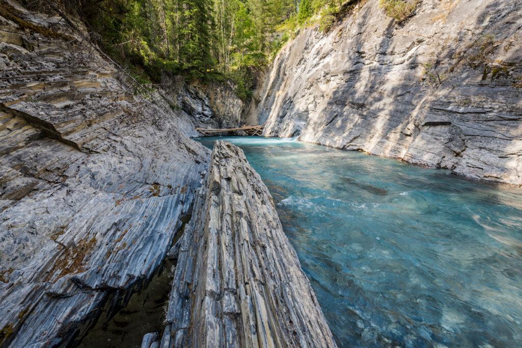 Beautiful clear turquoise mountain river below the natural bridge new Radium Hot Springs British Columbia on the Nipika Trails.