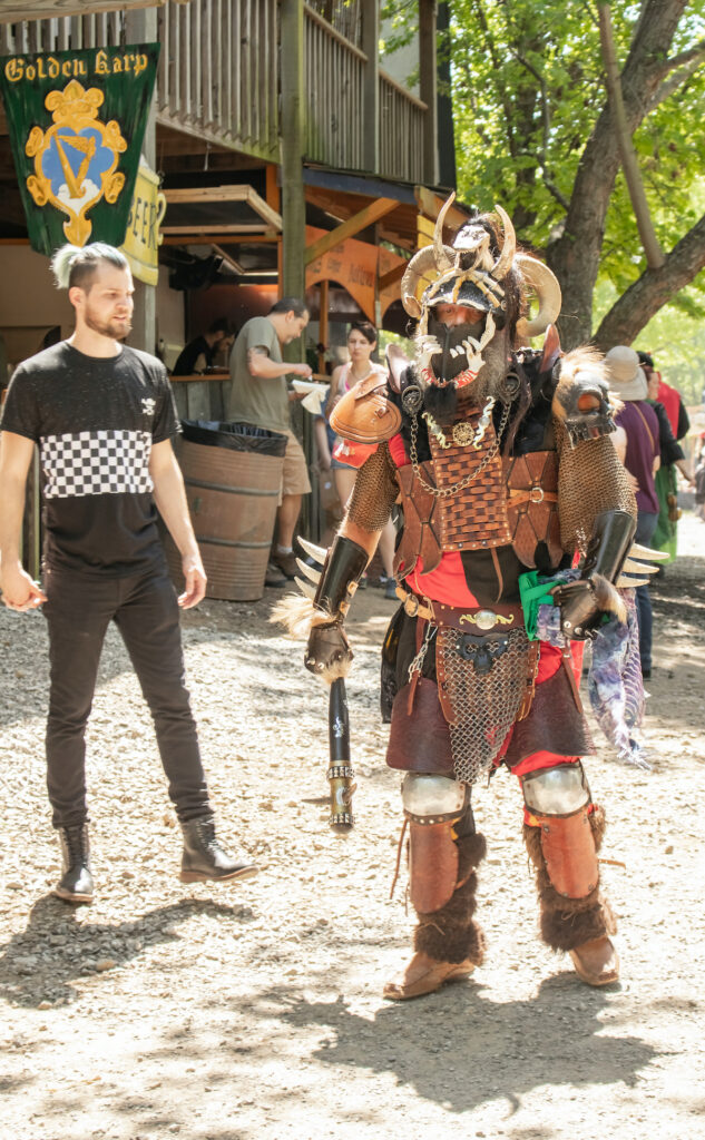 Man in full body barbarian costume complete with horned helmet at the Oklahoma Renaissance Festival in Muskogee Oklahoma.