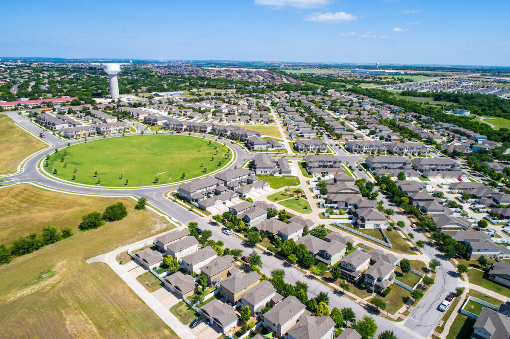 Aerial of houses in huge circle architecture design in Pflugerville, Texas.