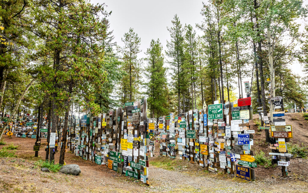 A view of the Watson Lake Sign Post Forest in Yukon, Canada. Visitors can add their own signs to the over 80,000 already present.