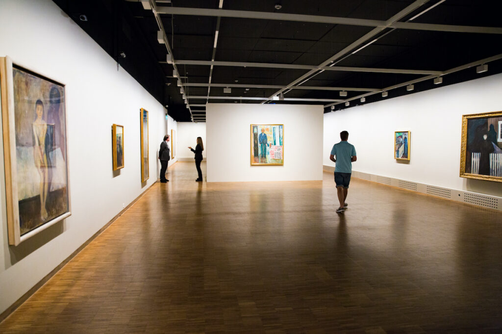 Inside the Munch Museum of the Norwegian artist Edvard Munch in Oslo. Hall with art works, pictures on the walls, visitors.