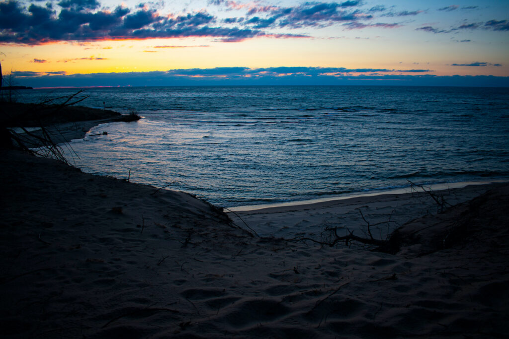 Sunset over Lake Huron, River, and Sand Dunes in Port Crescent State Park, Port Austin Michigan.