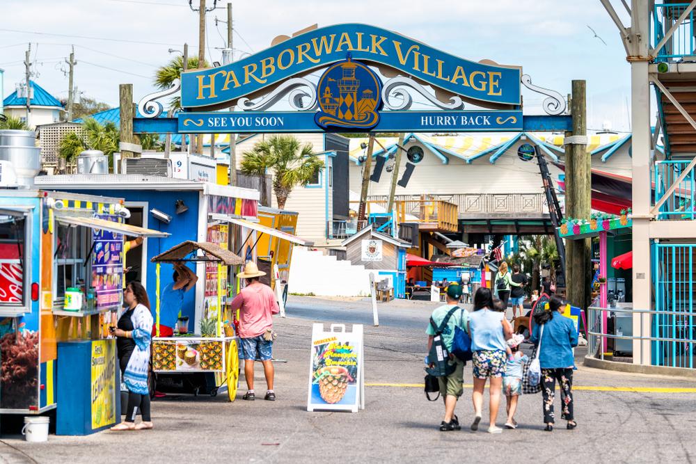 People walking around in Harborwalk Village in Emerald Grande Coast in Destin, Florida
