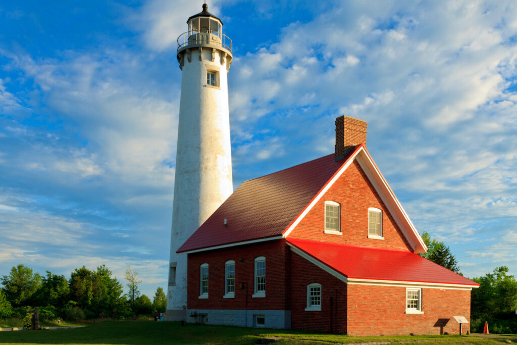Evening photo of historic Lake Huron Lighthouse at Tawas Point State Park.