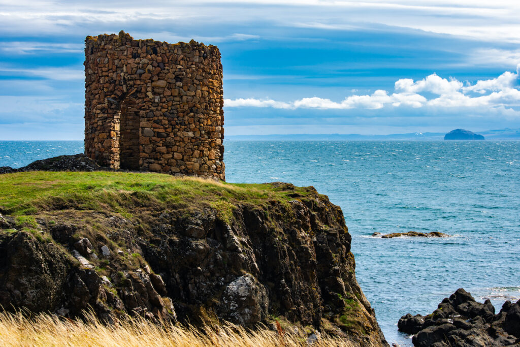 Beautiful Scottish landscape with the Lady's Tower on a cliff close to the sea in a sunny day in Elie, Scotland.