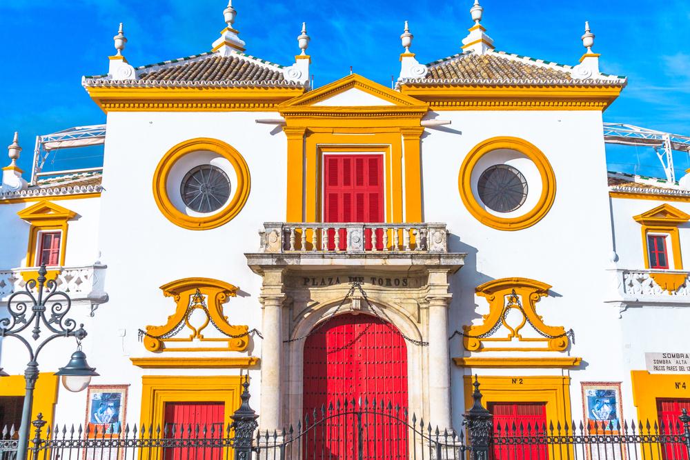 Seville, Andalusia, Spain - April 19, 2016: Baroque facade of biggest Arena on of Square of Bulls Royal Maestranza of Cavalry or Real Maestranza Arena in Plaza de la Real Maestranza de Caballeria.