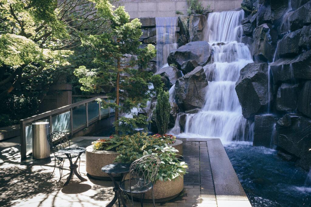 Waterfall flows in Waterfall Garden Park, a hidden park in Downtown Seattle.
