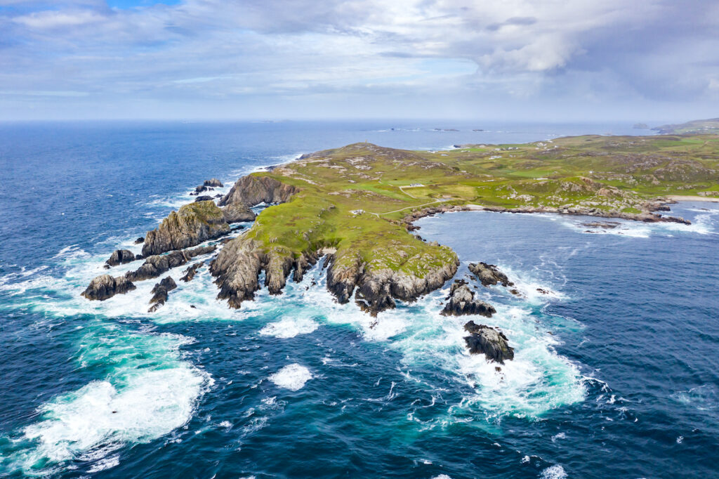 Waves crash along the clifts in this aerial view of the coastline at Malin Head in Ireland.