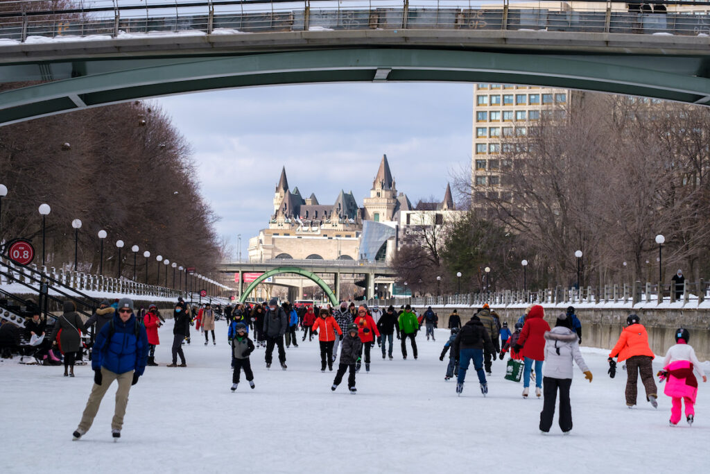 People skate on the ice along the frozen waters of the Rideau Canal Skateway in downtown Ottawa.
