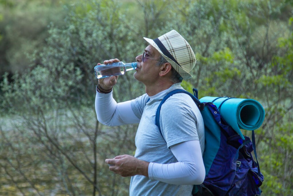 Hiker stopping to rest and drink water.