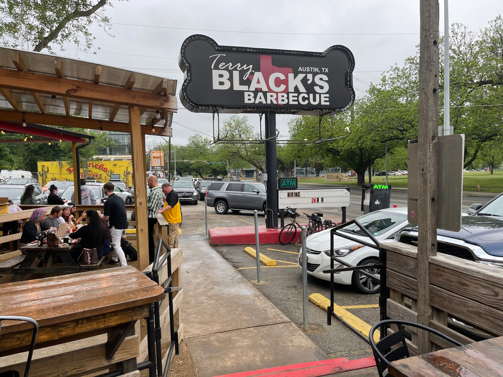 People eating outdoors at Terry Black's Barbecue Restaurant in Austin, TX