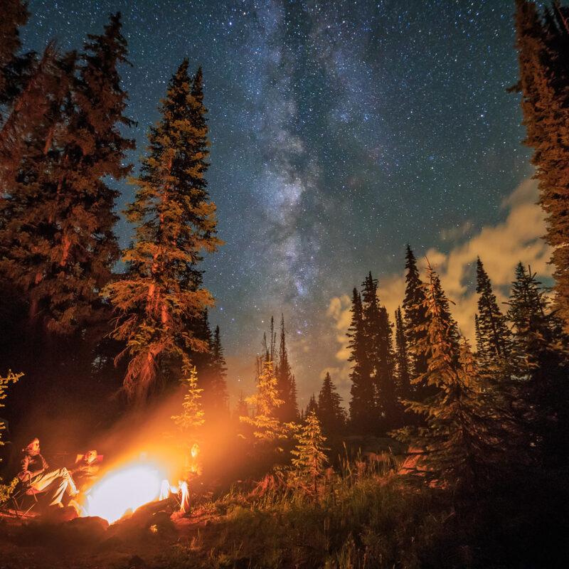 Family camping at night near Rocky Mountain National Park
