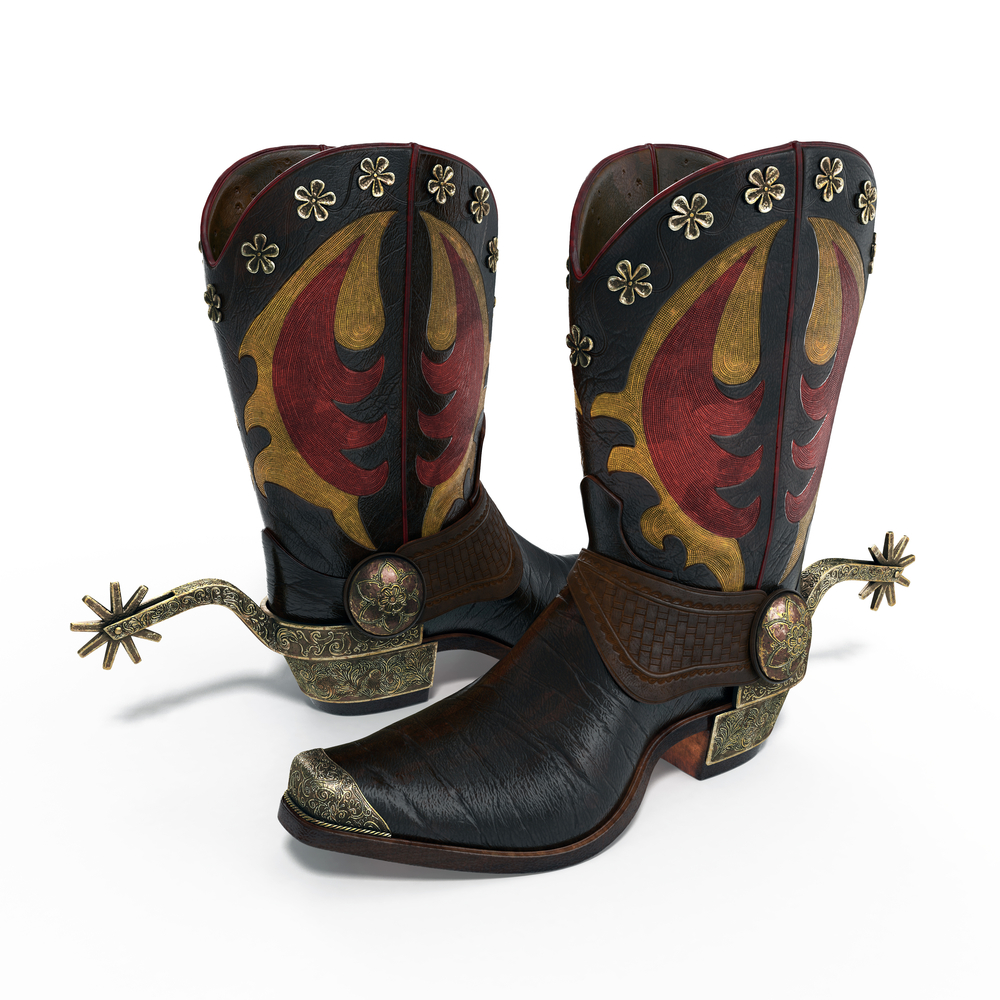 cowboy boots with spurs on white background