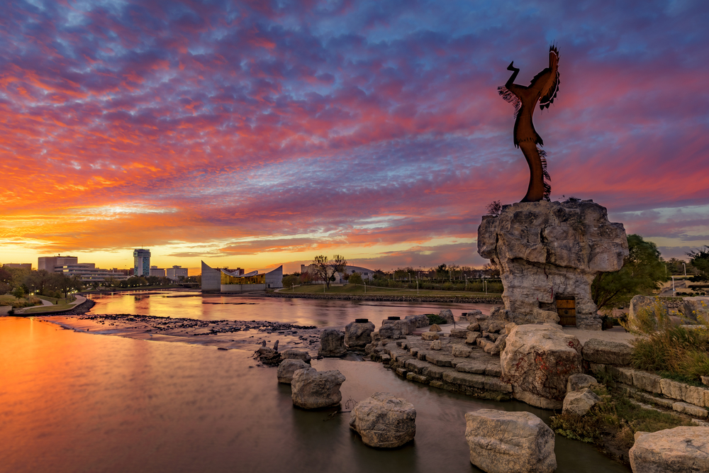 Keeper of the Plains and Wichita skyline at sunrise