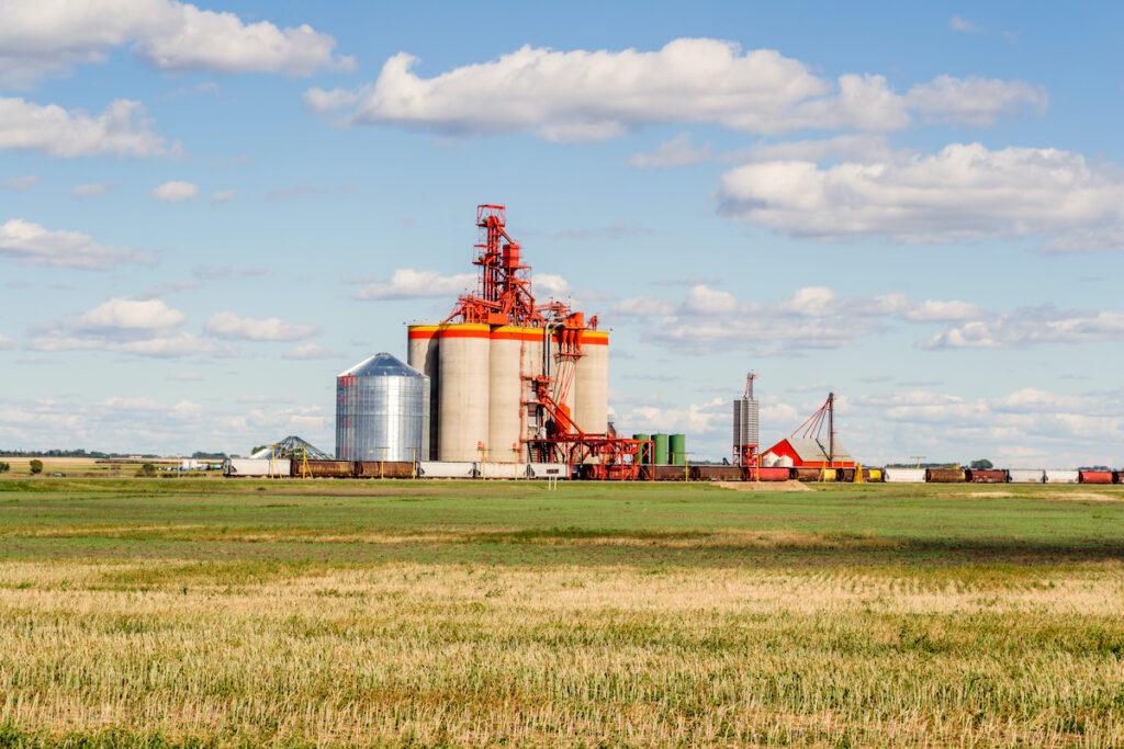 A suburban terminal for grain storage with a railway and trains near Weyburn, Saskatchewan, Canada.