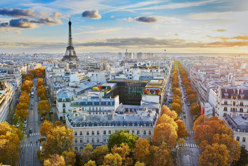 Aerial panoramic cityscape view of Paris, France with the Eiffel tower on a fall day.