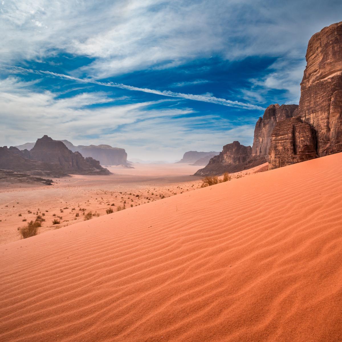 Dunes and rock formations in Wadi Rum, Jordan.