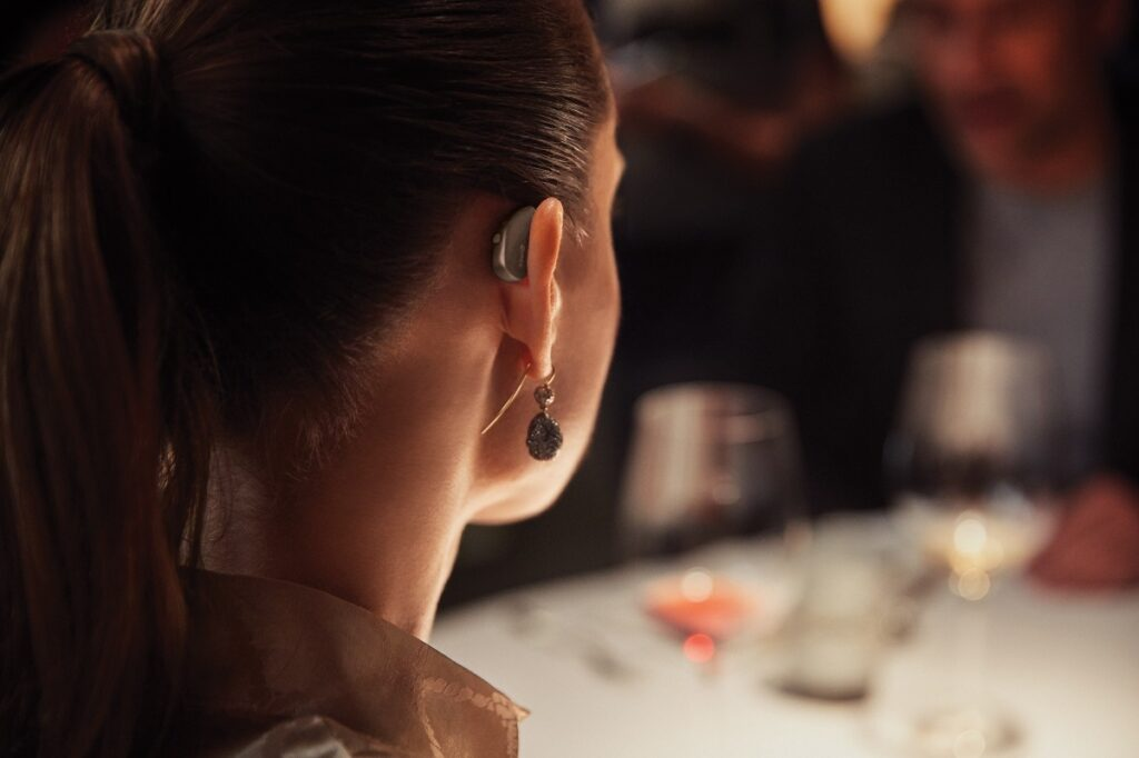 Woman wearing Widex hearing aid