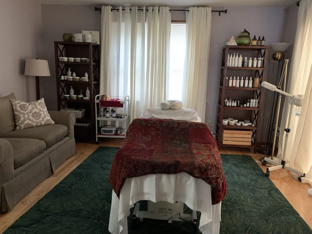 Wellness treatment room with massage table.