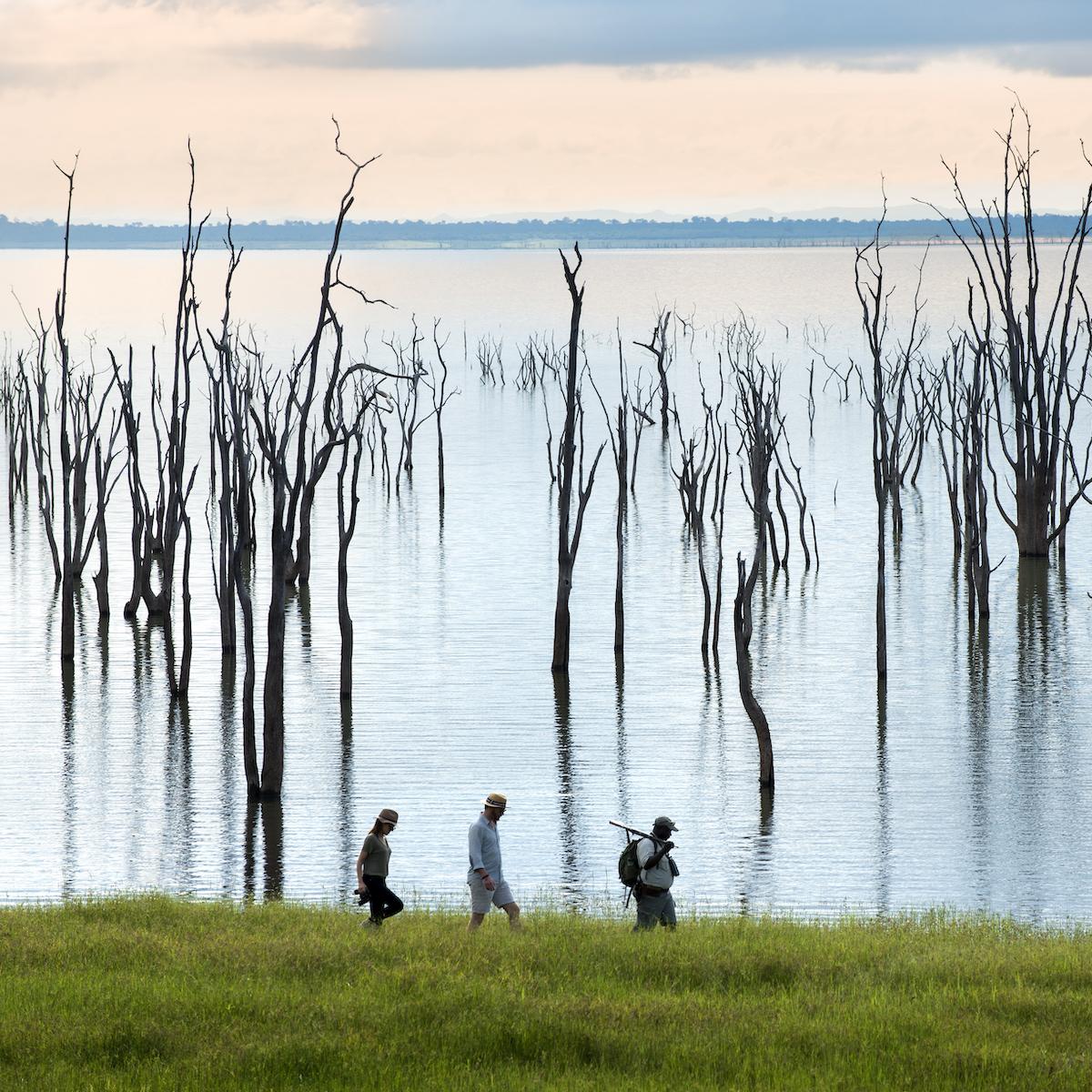 People walking along Lake Kariba.