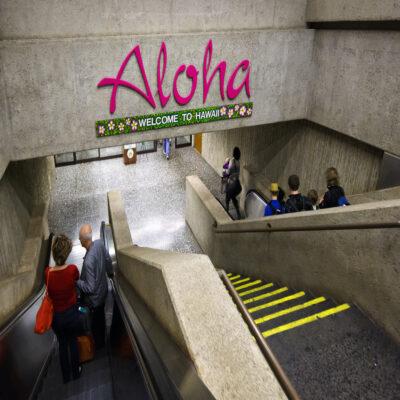 Escalators leading towards the exit of Honolulu Airport