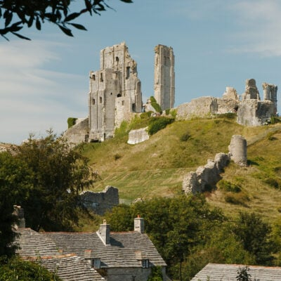 A landscape view of the ruins of Corfe Castle